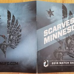 The front and back of the 2018 match day guide.