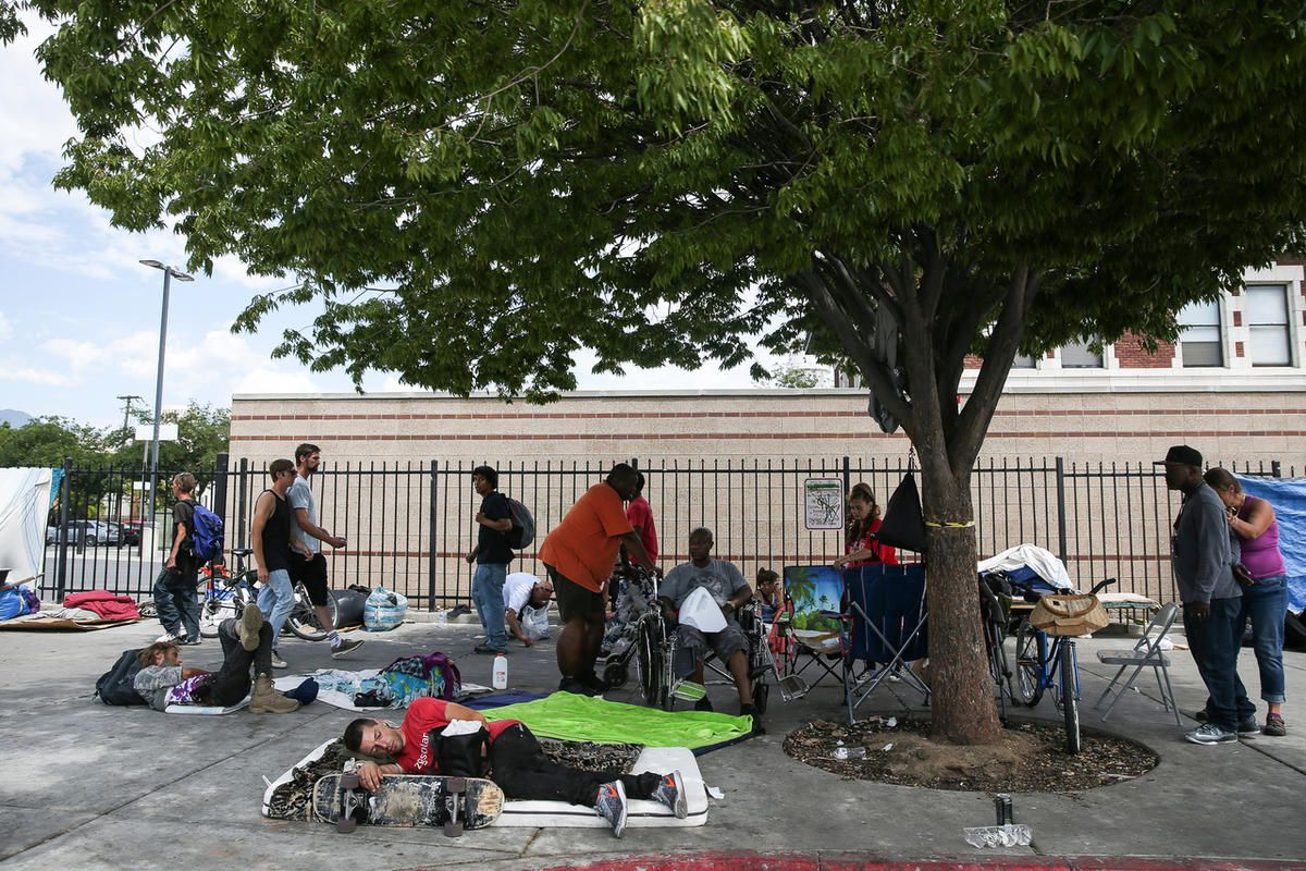 FILE - Homeless individuals camp on 500 West in the Rio Grande area of Salt Lake City on Friday, July 28, 2017.
