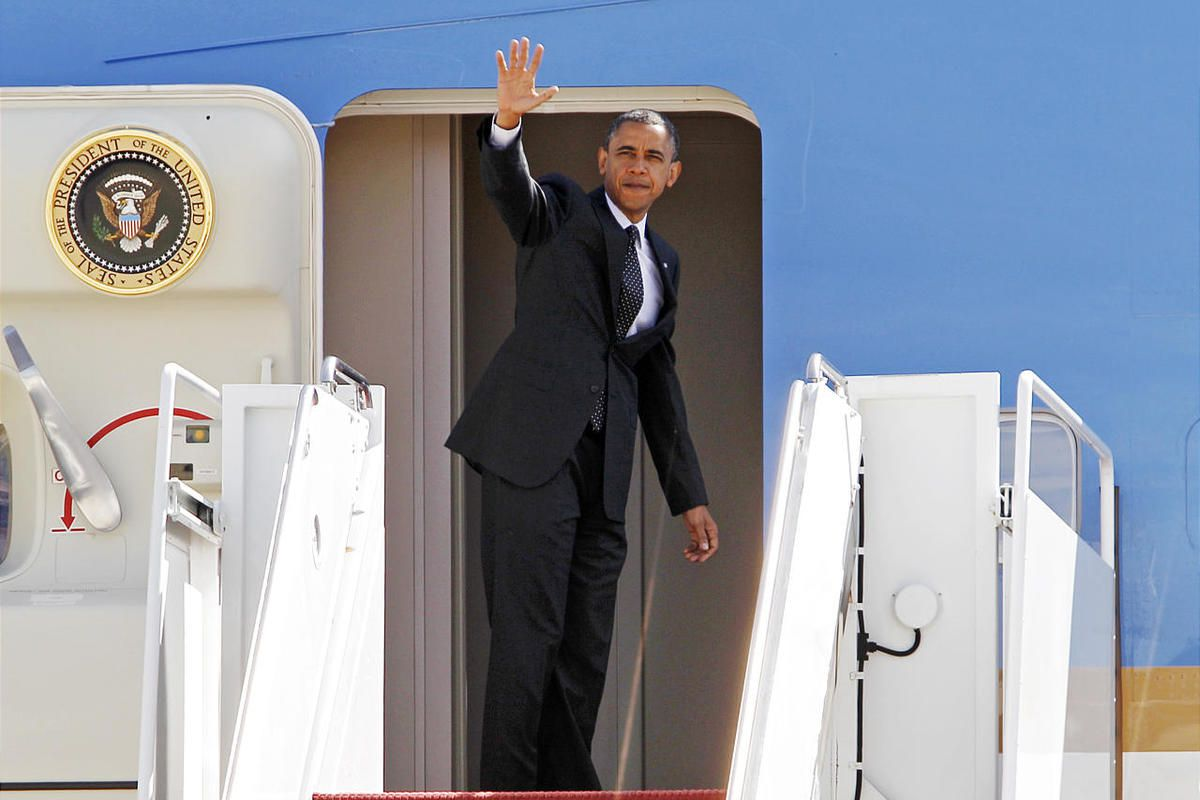 President Barack Obama waves from Air Force One.