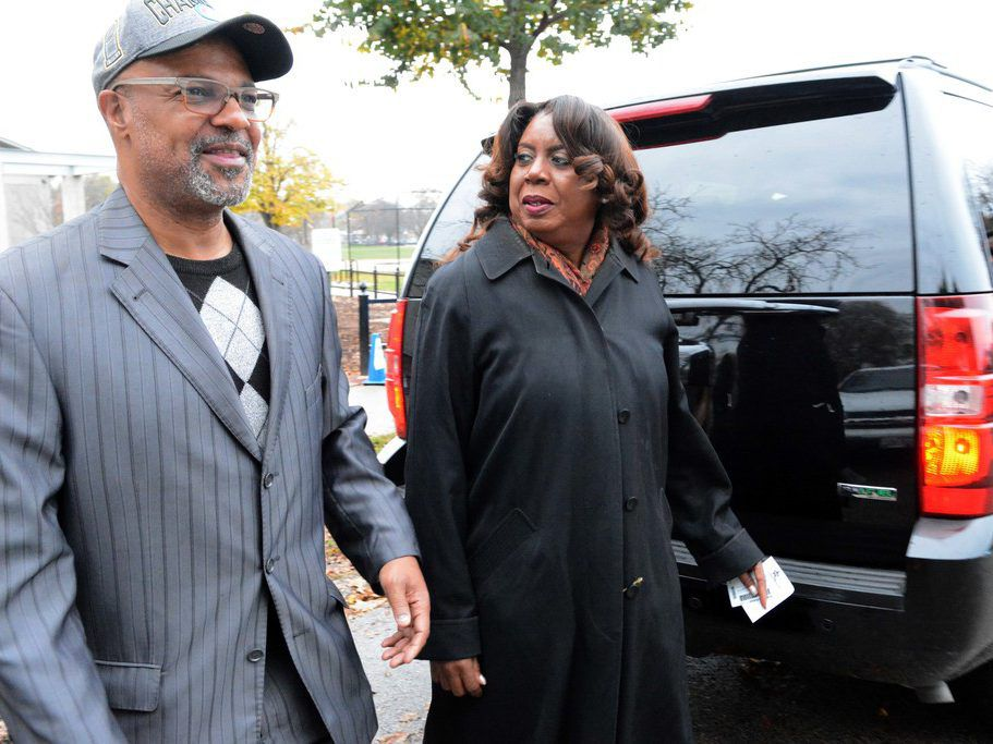 Benton Cook III and County Clerk Dorothy Brown leave a polling place in November 2016. File Photo. Brian Jackson/ For the Sun-Times