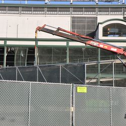 Fence (or gate) being lifted into place behind the Clark Street fence