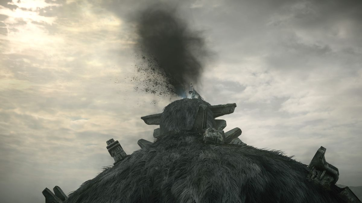 Shadow of the Colossus remake - Wander stabs a colossus, sending a spray of black blood into the air