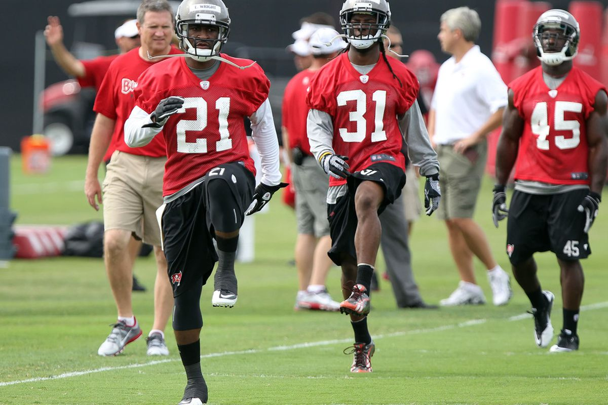 May 15, 2012; Tampa, FL, USA;  Tampa Bay Buccaneers cornerback Eric Wright (21), defensive back E.J. Biggers (31) and linebacker Rennie Curran (45) workout during organized team activities at One Buc.   Mandatory Credit: Kim Klement-US PRESSWIRE