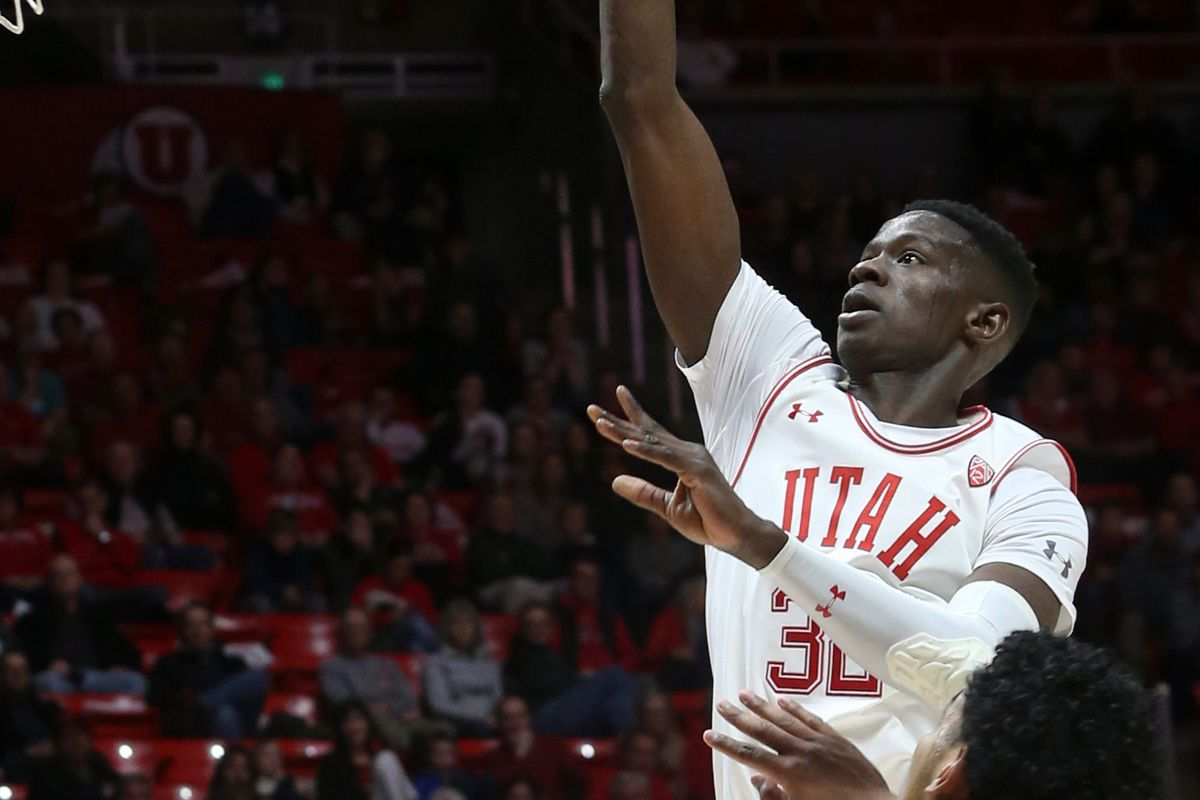 Utah Utes center Lahat Thioune (32) attempts to score against the California Golden Bears at the Huntsman Center in Salt Lake City on Saturday, Feb. 8, 2020.