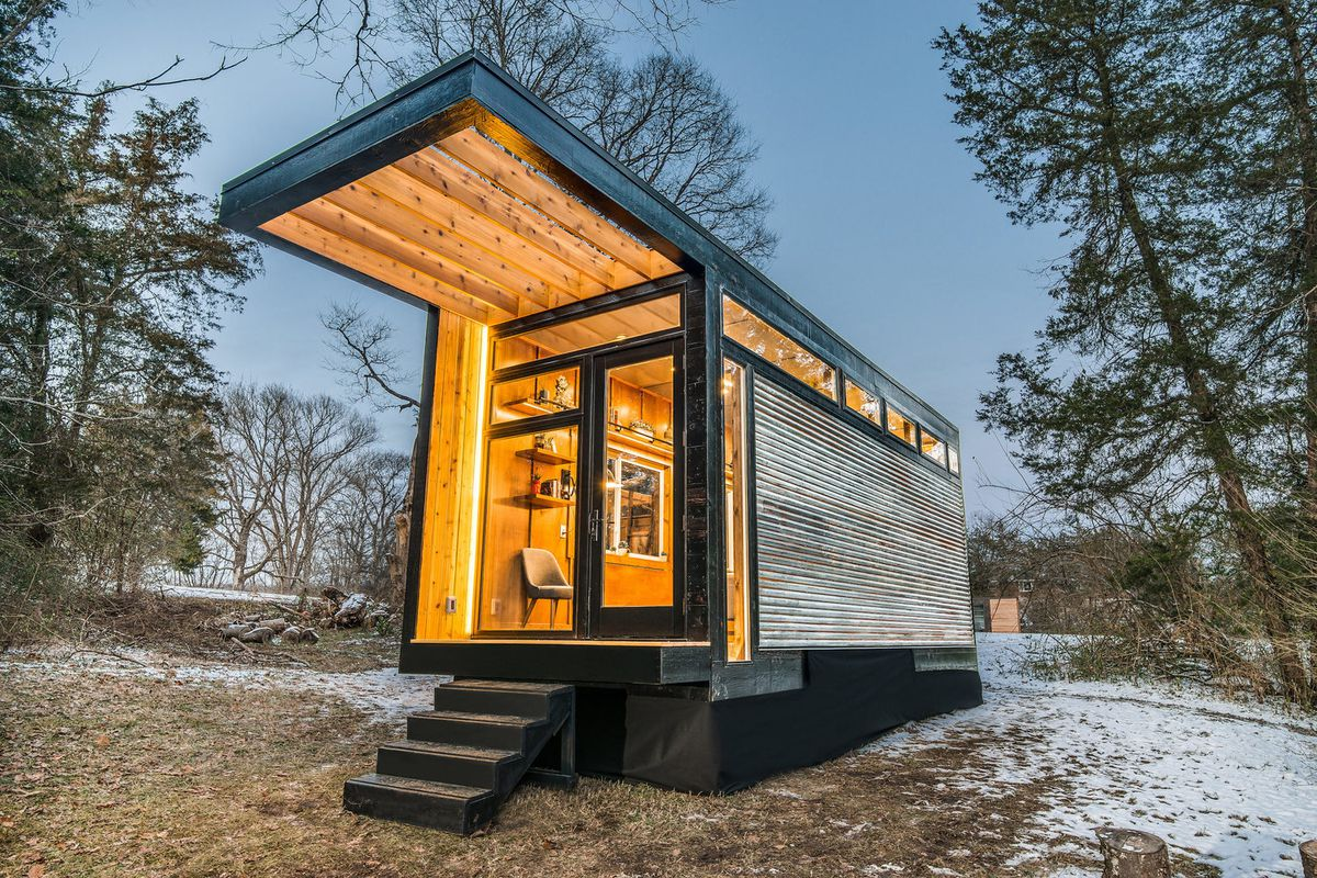 new tiny house also serves as writing studio and library curbed. Black Bedroom Furniture Sets. Home Design Ideas