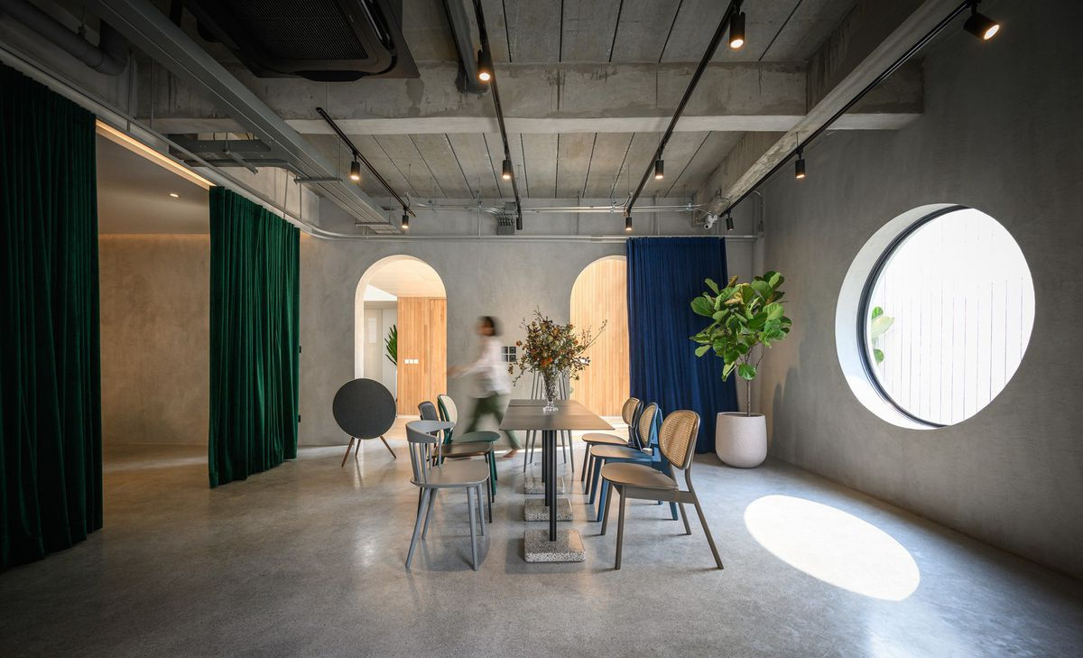 Dining room with concrete floors and circular window