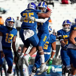 Orem's Paxton Skipps and Devon Sa-Chisolm celebrate after Skipps ran the ball for a touchdown, making the score tied at 6, in the 5A football state championship game against Timpview at Cedar Valley High in Eagle Mountain on Friday, Nov. 20, 2020.