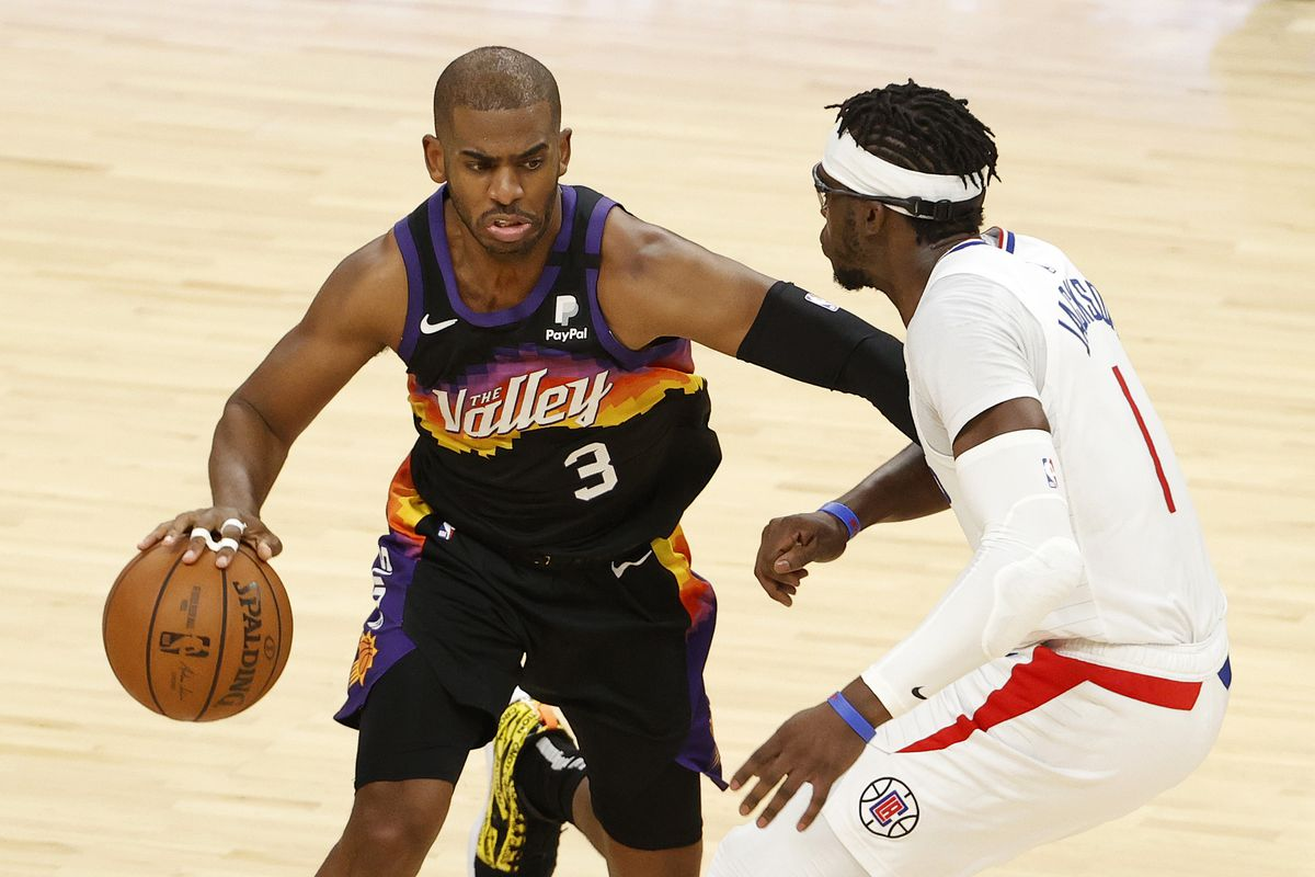 Chris Paul of the Phoenix Suns drives to the basket against Reggie Jackson of the LA Clippers during the first half in Game Five of the Western Conference Finals at Phoenix Suns Arena on June 28, 2021 in Phoenix, Arizona.