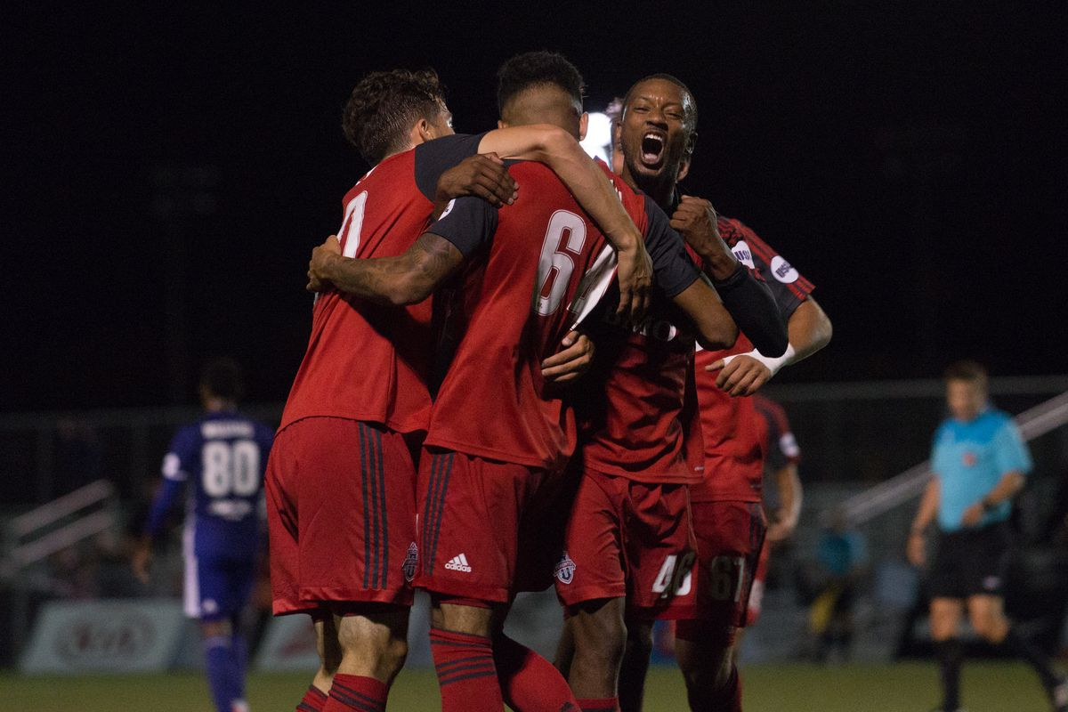 USL Photo - TFC II players (Hundal, McCrary, Srbely) celebrate the game-winner against Louisville City FC at the Ontario Soccer Centre
