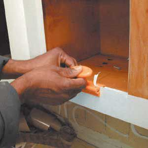 <p>1. After they have removed all of the old cabinet doors, installers then sand the face frames. It takes a two-person crew about two days to complete a refacing job in an average-size kitchen.</p>