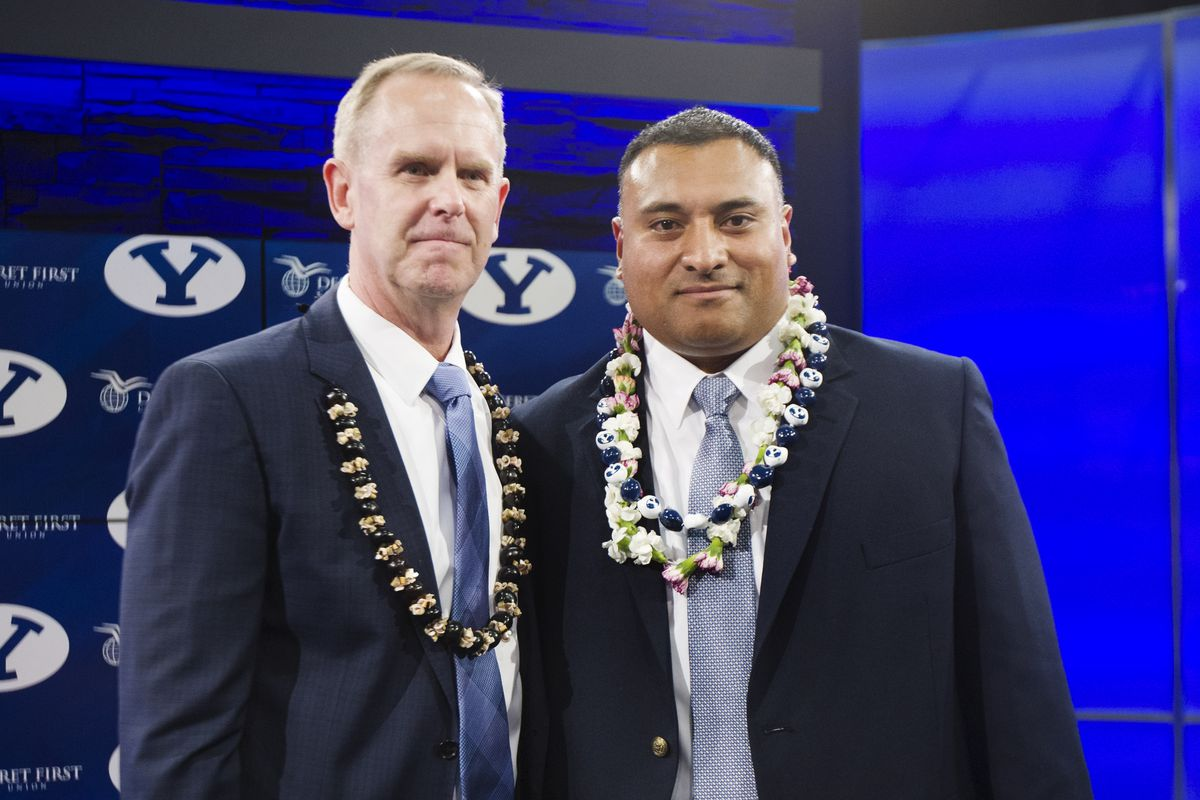 BYU's director of athletics Tom Holmoe, poses with new head football coach Kalani Sitake following a press conference in Provo Monday, Dec. 21, 2015.