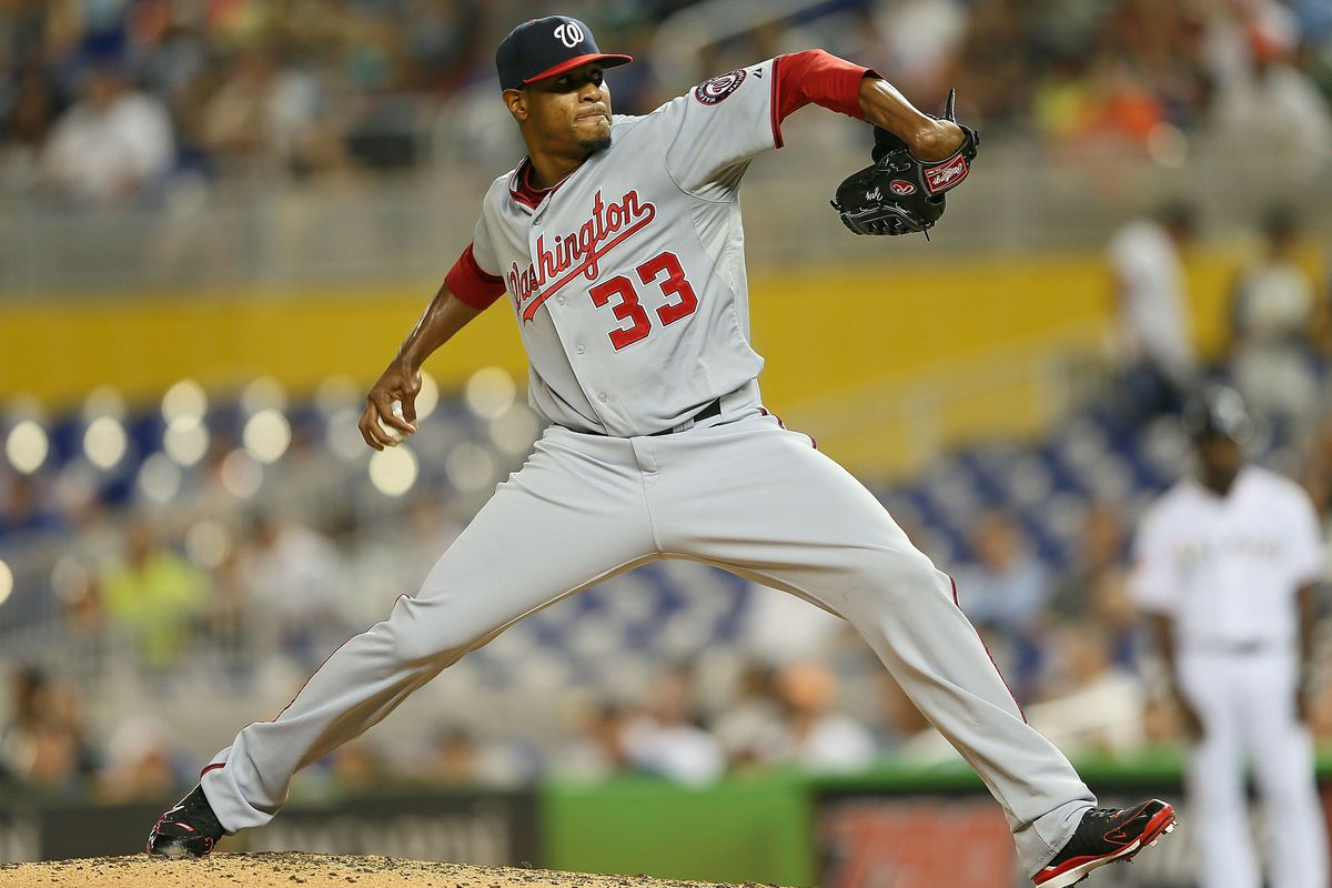 MIAMI, FL - JULY 16:  Edwin Jackson #33 of the Washington Nationals pitches during a game against the Miami Marlins at Marlins Park on July 16, 2012 in Miami, Florida.  (Photo by Mike Ehrmann/Getty Images)