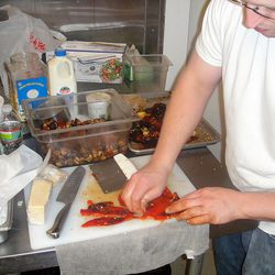 Afte roasting the peppers, they're sliced up.