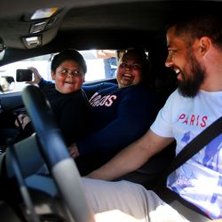 Adrian Zamarripa smiles at Jeremy Neves, owner of a Lamborghini Huracan, after Adrian and his mother, Beatriz Flores, went for a ride in Ogden on Tuesday, May 5, 2020 in Ogden. Adrian, who is 5, tried to drive his parents' car to California to get his own Lamborghini on Monday, He was stopped by the Utah Highway Patrol just a few miles from his home.