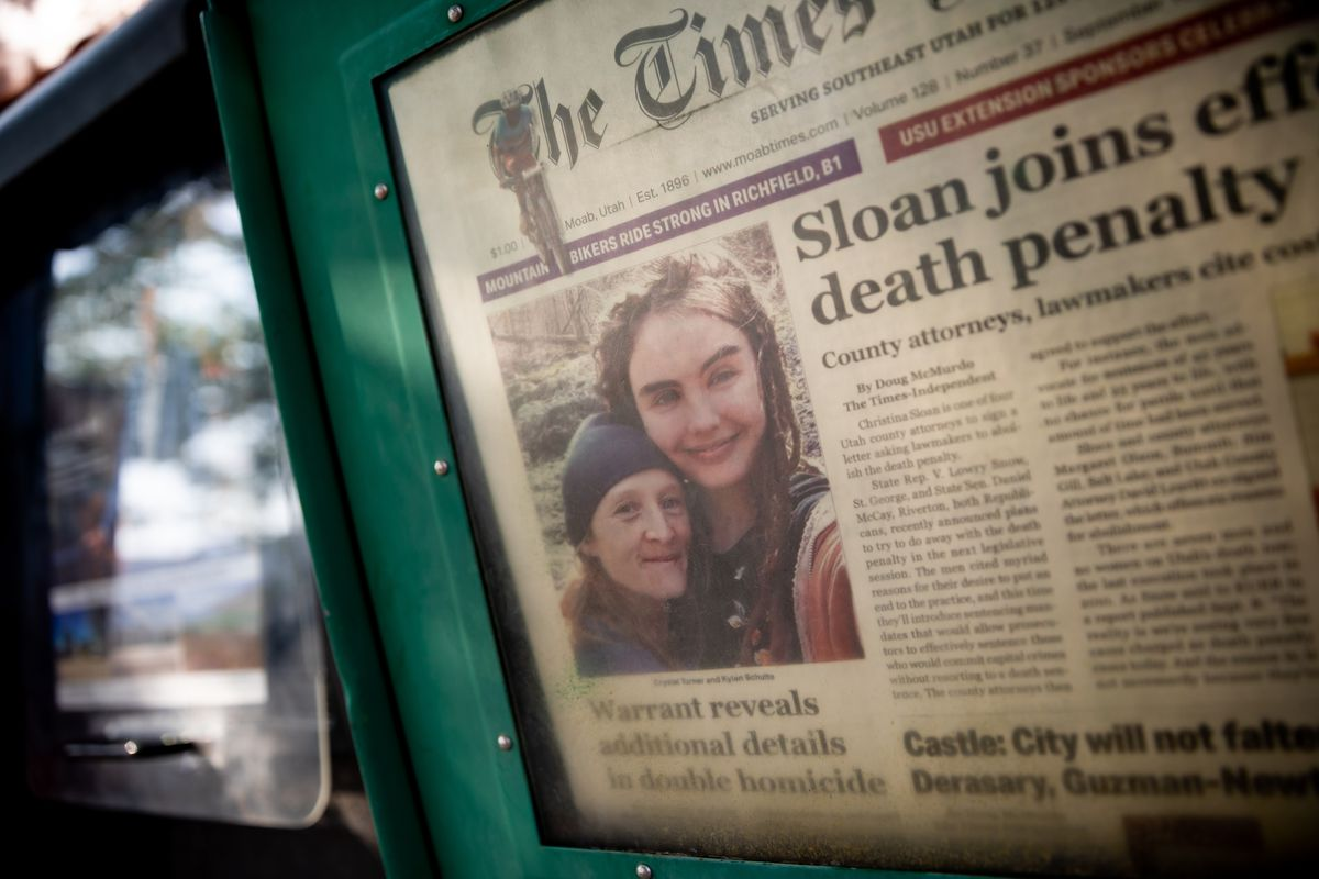 Crystal Turner and Kylen Schulte are pictured on the front page of The Times-Independent in a newspaper rack outside of the Moonflower Community Cooperative, where Schulte worked, in Moab on Sunday, Sept. 19, 2021.