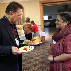 Kirit Daftary, of the Parliament of the World Religions, chats with Indra Neelameggham, of the Hindu community of Utah, at the annual Interfaith Prayer Breakfast at the Hellenic Cultural Center in Salt Lake City on Thursday, Feb. 5, 2015.
