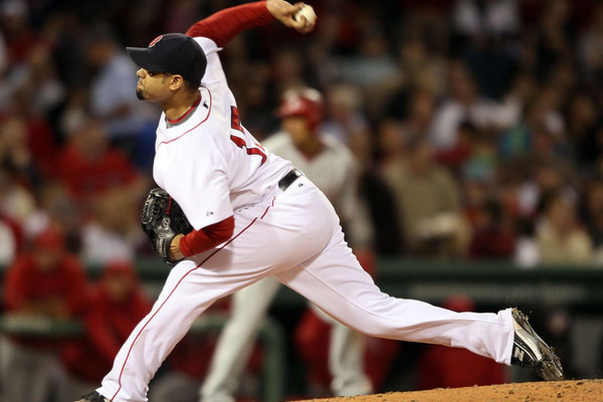 BOSTON - MAY 06:  Manny Delcarmen #17 of the Boston Red Sox delivers a pitch in the sixth inning against the Los Angeles Angels of Anaheim on May 6, 2010 at Fenway Park in Boston, Massachusetts.  (Photo by Elsa/Getty Images)