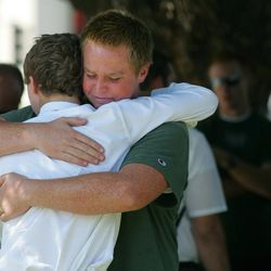 Stephen Henriksen, right, gets a hug from fellow church member Ryan Henshaw after a shooting that killed lay bishop Clay Sannar of the Church of Jesus Christ of Latter-Day Saints Sunday, Aug. 29, 2010 in Visalia, Calif. (AP Photo/The Fresno Bee, Gary Kazanjian)
