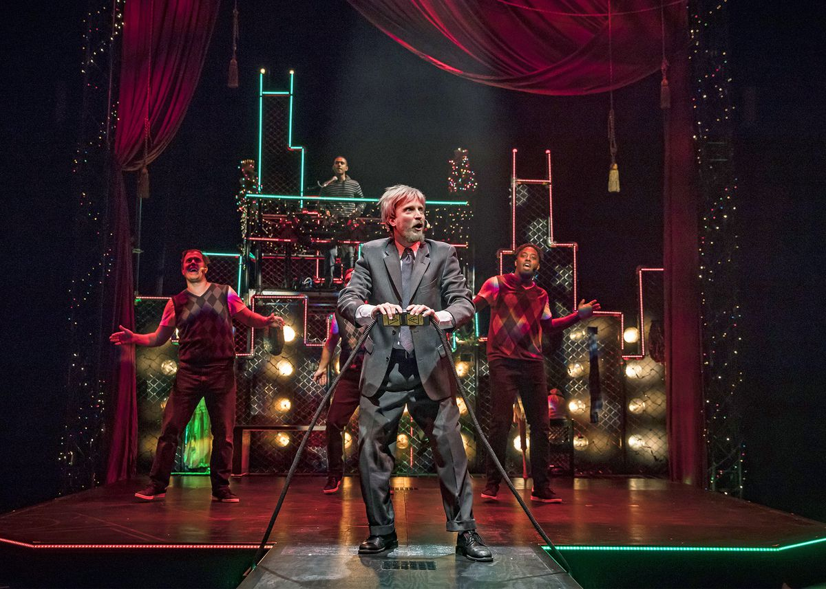 """John Hoogenakker as Scrooge embraces the magic of the holiday season in Chicago Shakespeare Theater's production of """"Q Brothers Christmas Carol"""" at The Yard at Chicago Shakespeare. 