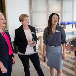 Cydni Tetro, left, and Sara Jones, second from right, greet participants at the Women Tech Awards finalist judging session in Salt Lake City on Thursday, July 28, 2016.