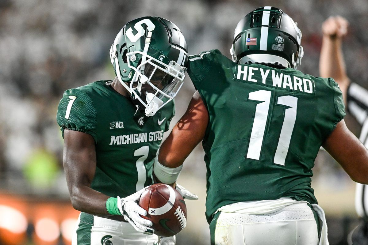 Michigan State's Jayden Reed, left, celebrates with Connor Heyward after Hayward's catch against Nebraska during the second quarter on Saturday, Sept. 25, 2021, at Spartan Stadium in East Lansing.