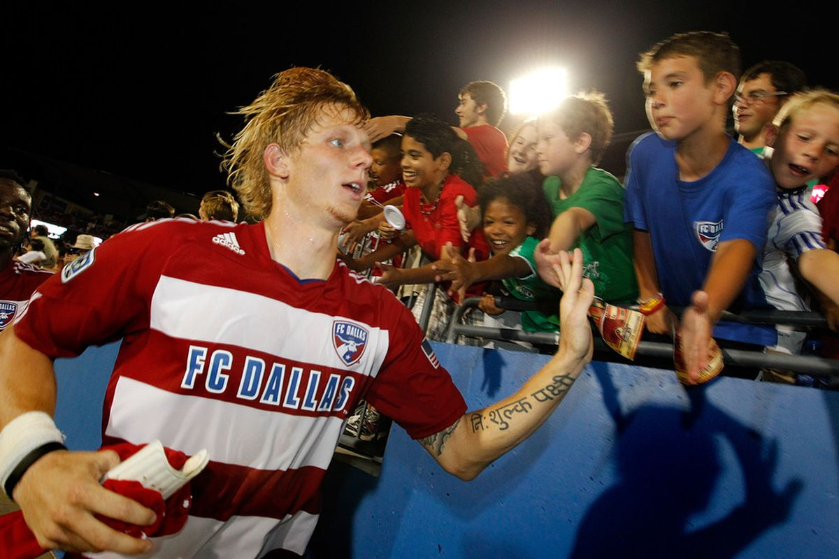FRISCO, TX - JULY 02:  Brek Shea #20 of the FC Dallas celebrates with fans after FC Dallas beat Columbus Crew 2-0 at Pizza Hut Park on July 2, 2011 in Frisco, Texas.  (Photo by Tom Pennington/Getty Images)