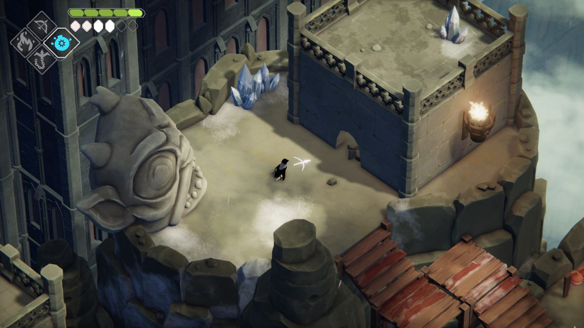 A crow stands in front of a hole in the wall in front of a goblin head