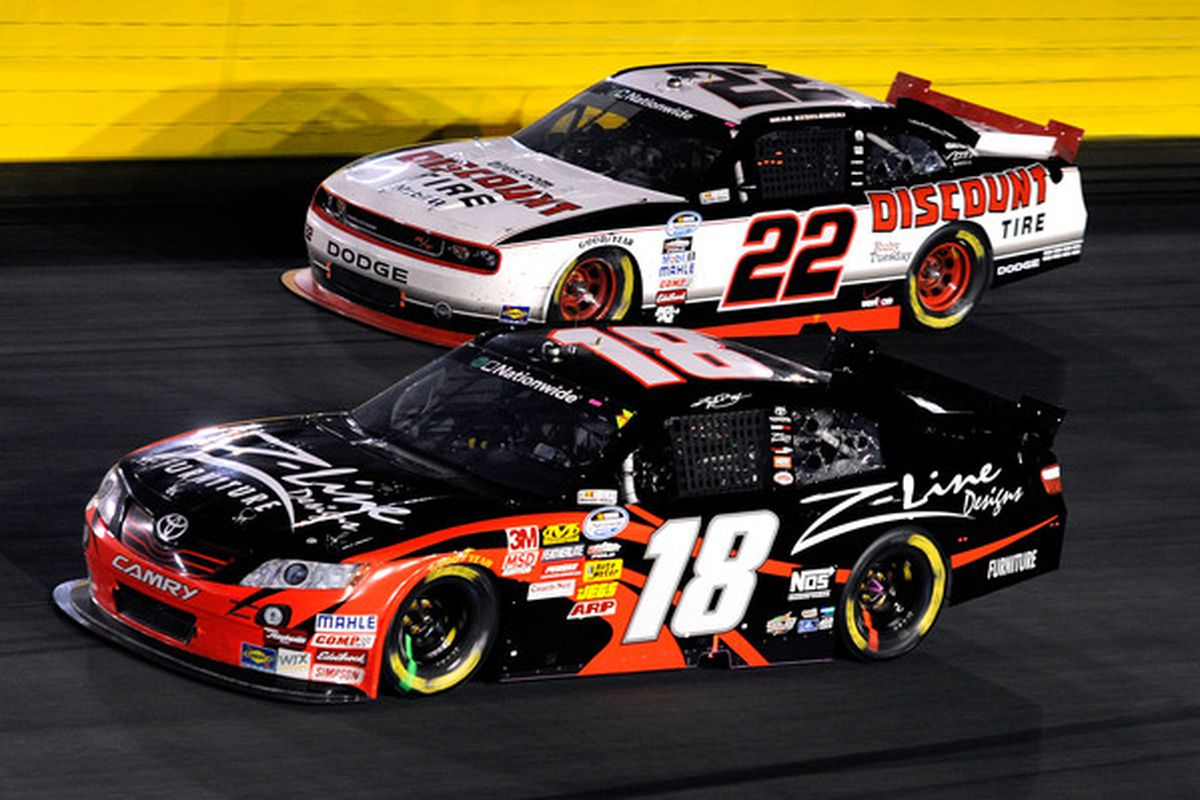 Kyle Busch (18) battles with Brad Keselowski during the NASCAR Nationwide Series Dollar General 300 at Charlotte Motor Speedway in October.
