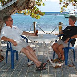 Ken and Linda Jordan of Michigan relax outside the Tiara Beach Hotel on Cayman Brac on Oct. 8. The Jordans were the first tourists to visit since Hurricane Ivan. They had use of a 40-foot boat all to themselves.