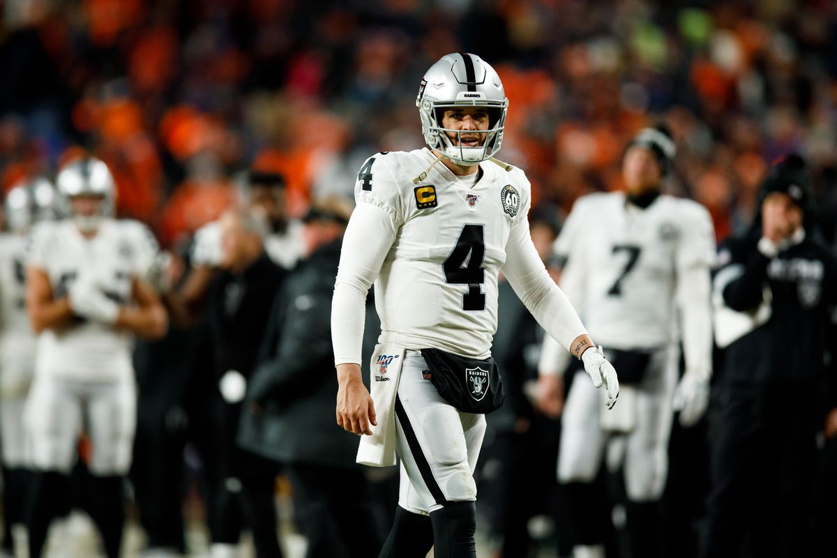 Quarterback Derek Carr of the Oakland Raiders walks on the field against the Denver Broncos during the fourth quarter at Empower Field at Mile High on December 29, 2019 in Denver, Colorado. The Broncos defeated the Raiders 16-15.