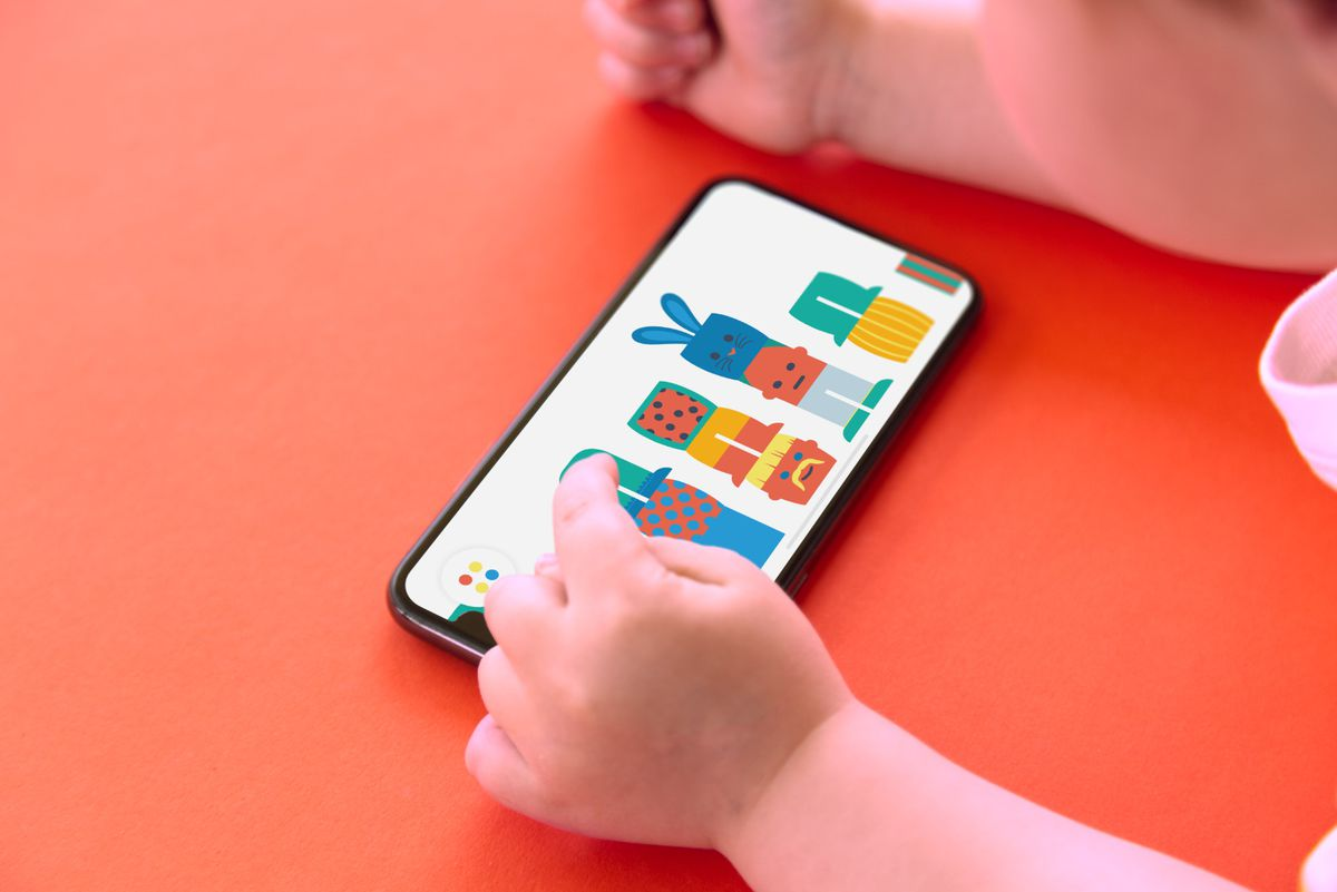 A child using an iPhone