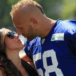 New York Giants linebacker Mark Herzlich greets his girlfriend Danielle Conti on Saturday. [ohn Munson/The Star-Ledger via USA TODAY Sports]