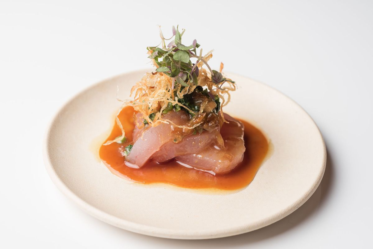 Sashimi at Umi by Hamasaku shown on white plate.
