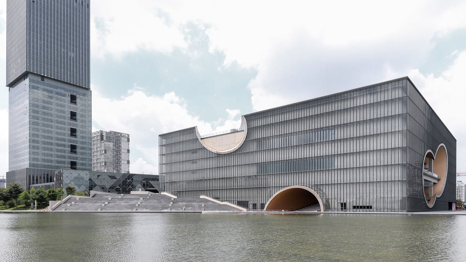 Tadao Ando Designed Theater In Shanghai Features Large Circular Cutouts Curbed