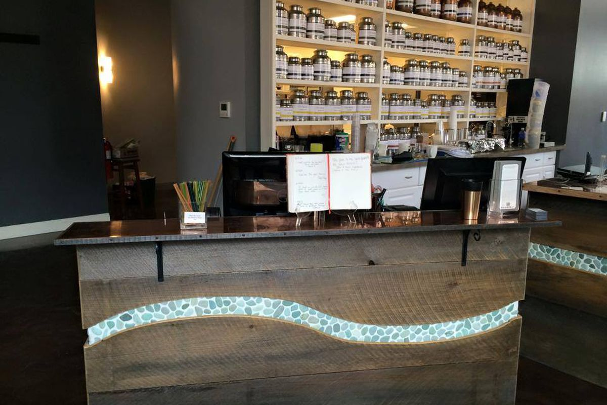 Guest services desk and tea selection at the new Soakology location.
