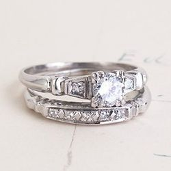 "<b>Erica Weiner</b> <a href=""http://ericaweiner.com/collections/antique-jewels/products/deco-wedding-set#.U5B5JJRdVbw"">Late Deco Wedding Set</a>, $3000"