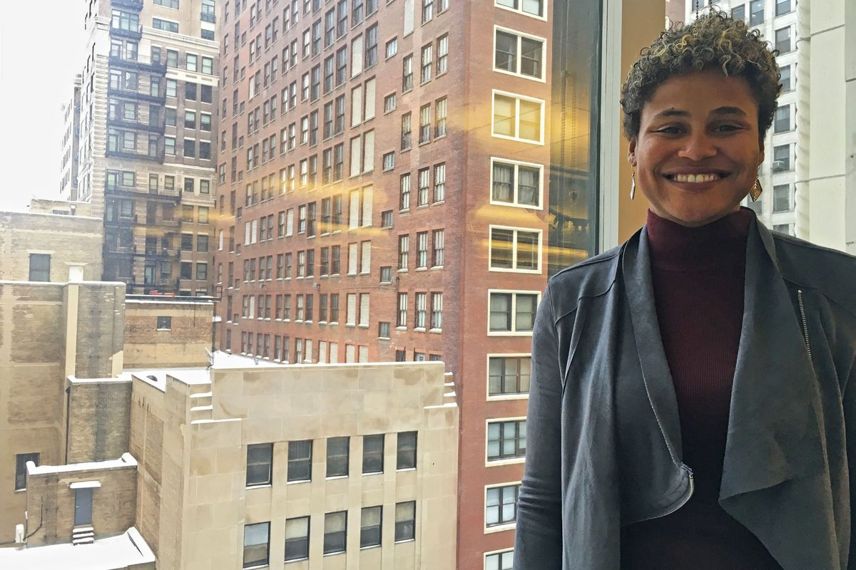 Noble CEO Constance Jones stands in front of a window at the network's downtown office.