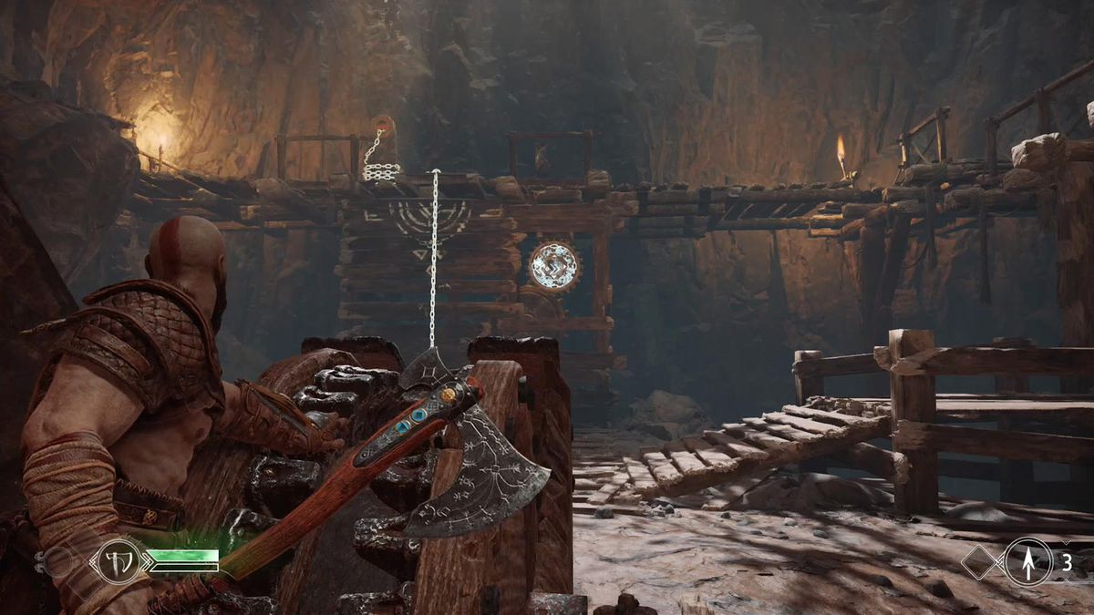 God of War - Kratos aiming his ax during a mechanical puzzle