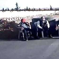 In this image taken from video obtained Wednesday, Sept. 19, 2012 from the Ugarit News, which has been authenticated based on its contents and other AP reporting, Free Syrian Army soldiers sit at a check point in Ain al-Arous town in Raqqa, Syria, on Tuesday, Sept. 18, 2012.