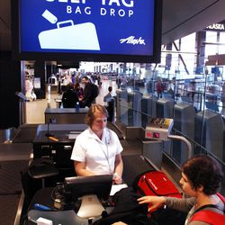 In this Monday, June 25, 2012, file photo, a customer drops off her bag at Seattle-Tacoma International Airport in Seattle. U.S. airlines collected more than $1.7 billion in baggage fees during the first half of the year, the largest amount ever collected in that six-month period. Delta Air Lines Inc. once again claimed the title as the airline collecting the most in baggage fees: nearly $430 million from January through June. The slightly larger United Airlines, part of United Continental Holdings Inc.,  followed with $351 million in bag fees, according to a report from the Bureau of Transportation statistics released Tuesday, Sept. 25, 2012. (AP Photo/Elaine Thompson, File)