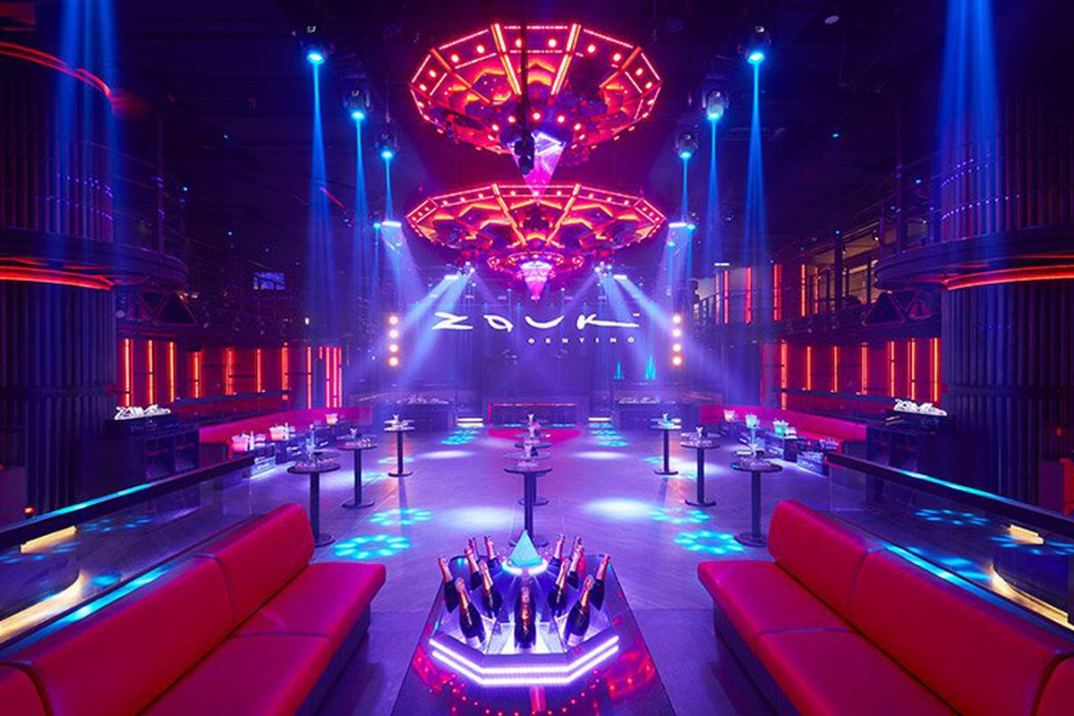 A nightclub with purple and pink lights.