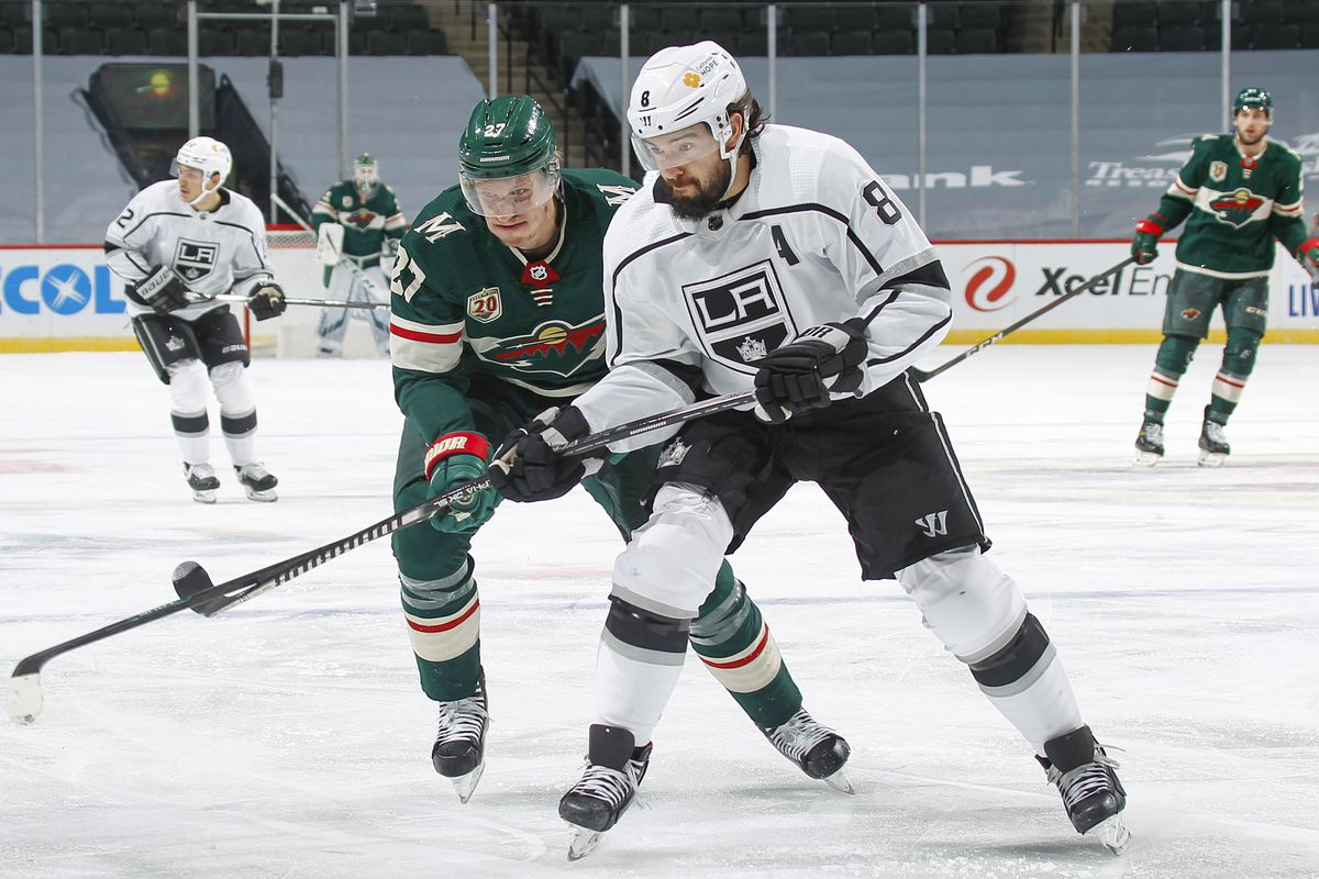 Ryan Suter #20 of the Minnesota Wild defends Drew Doughty #8 of the Los Angeles Kings during the game at the Xcel Energy Center on January 26, 2021 in Saint Paul, Minnesota.