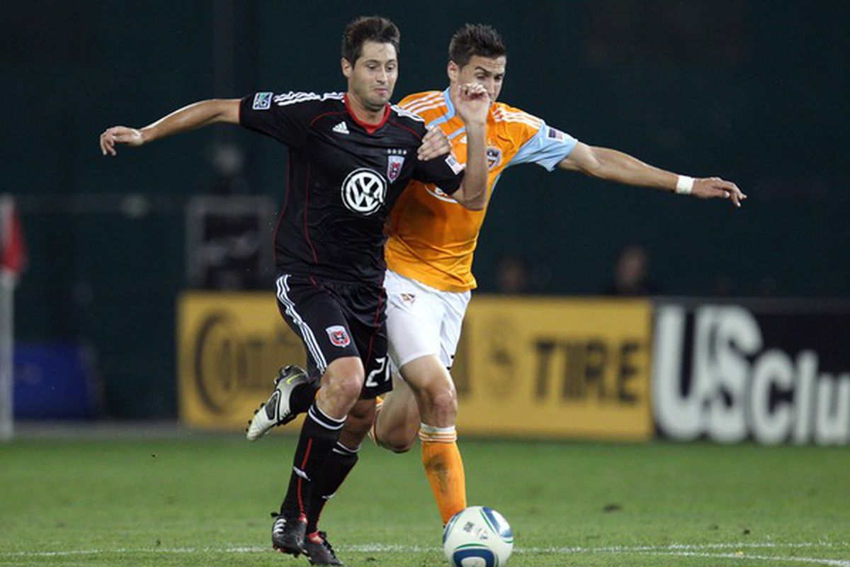 WASHINGTON - SEPTEMBER 25: Branko Boskovic #27 of D.C. United controls the ball against Geoff Cameron #20 of the Houston Dynamo at RFK Stadium on September 25 2010 in Washington DC. (Photo by Ned Dishman/Getty Images)