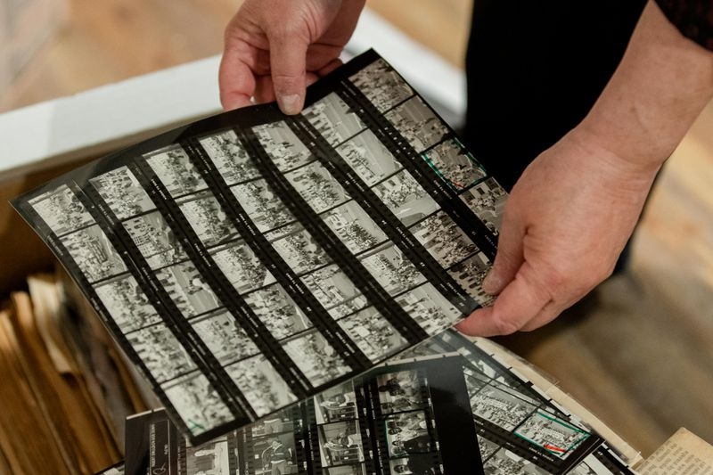 Tracy Baim, co-founder of Windy City Times and co-publisher of Chicago Reader, shows negatives that weren't printed in Windy City Times in her home in the Portage Park neighborhood, Friday morning, April 9, 2021.