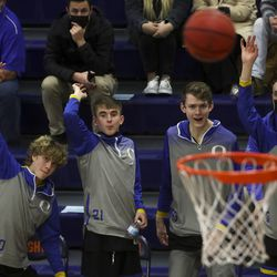 The Orem bench leaps up as they watch a 3-pointer go in during a second round boys 5A state basketball tournament game against the Bengals at Brighton High School in Cottonwood Heights on Friday, Feb. 26, 2021.