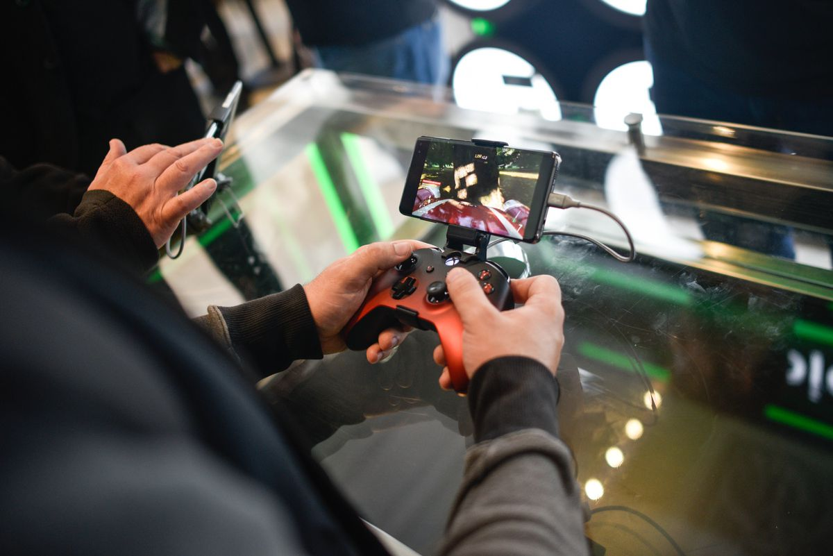 a customer plays Xbox One games on a mobile device at the xCloud display in the London Microsoft Store.