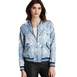 """<b>Marc by Marc Jacobs</b> Lame Metalasse Jacket, <a href=""""http://www.marcjacobs.com/marc-by-marc-jacobs/womens/ready-to-wear/outerwear-and-tops/m4002253/lame-matelasse-jacket?sort="""">$598</a>"""