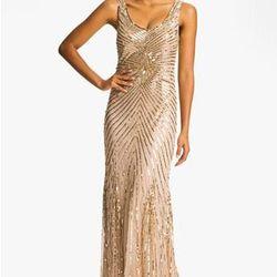 """<a href=""""http://shop.nordstrom.com/s/aidan-mattox-sequin-v-back-mesh-gown-online-only/3540942"""">Aidan Mattox Sequin V-Back Mesh Gown</a>, $450"""