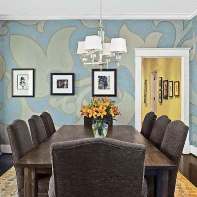 Blackboard chalk art drawn onto blue walls behind a dining table.