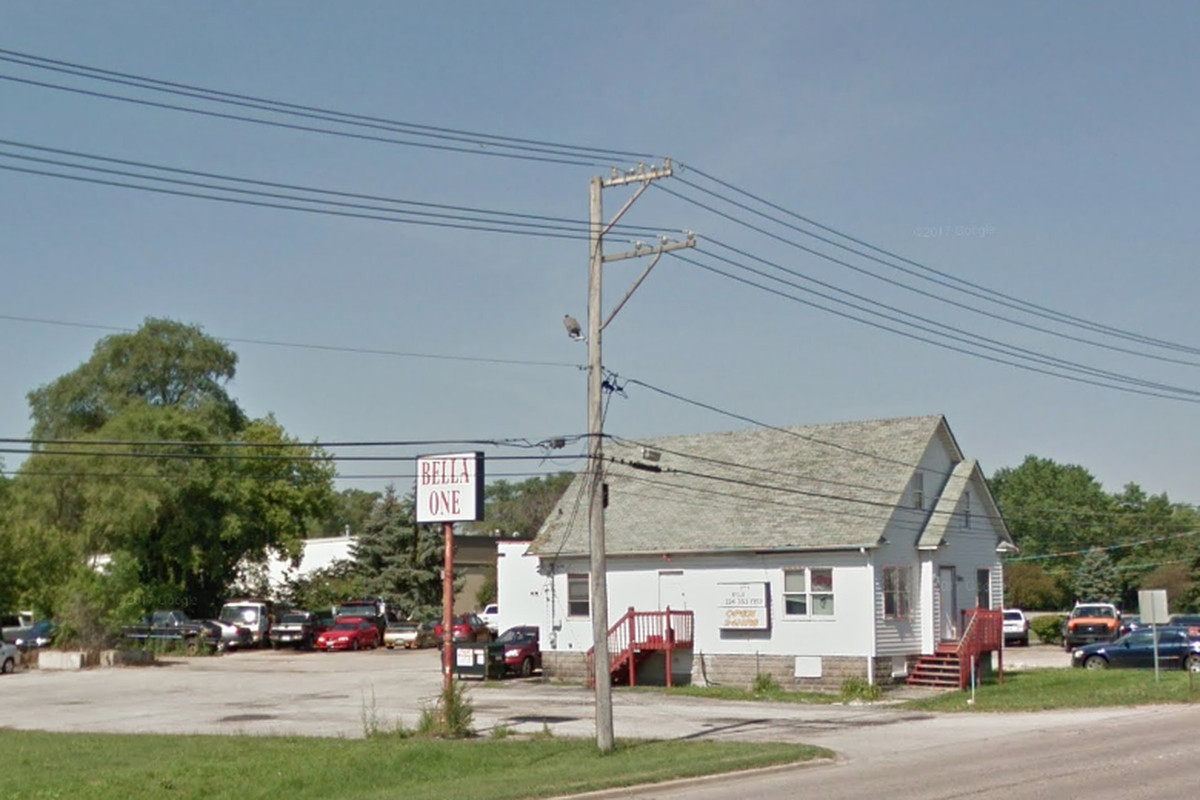 Person found dead after shots fired at Roselle mage parlor ... on